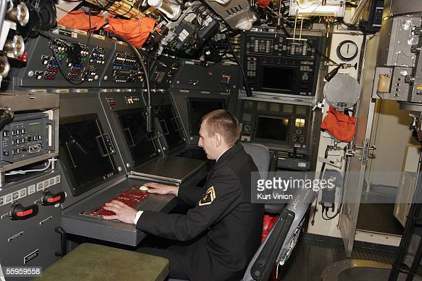 German submariner sits in the control room aboard the U32 a newly inaugurated Class 212 A submarine on October 19 2005 in Eckernfoerde Germany The...