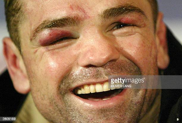 German super middleweight IBF and WBA title holder Sven Ottke jubilates at Nuernberg Arena 13 December 2003 after his fight against English...