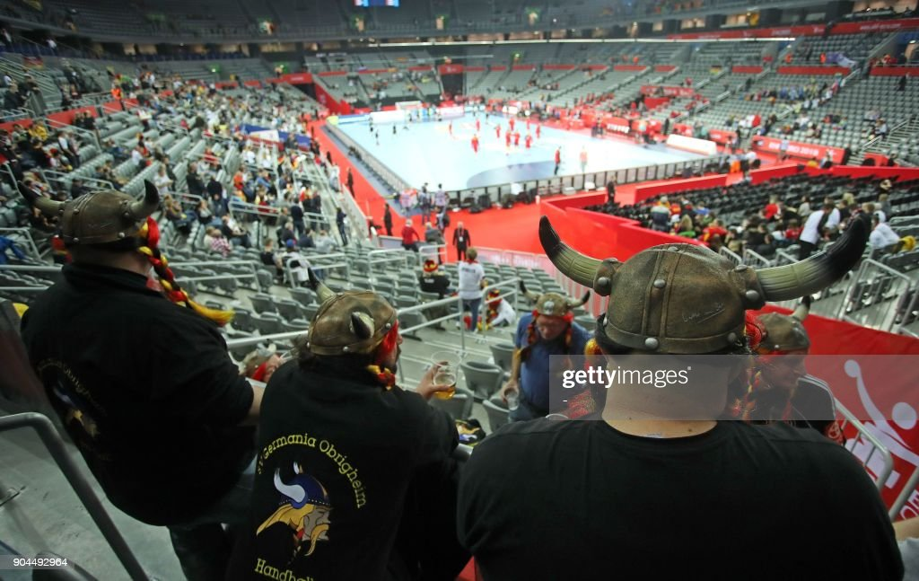 German suporters wearing Viking helmets wait for the start of the preliminary round group C match between Germany and Montenegro during the Men's 2018 EHF European Handball Championships in Zagreb on January 13, 2018. /