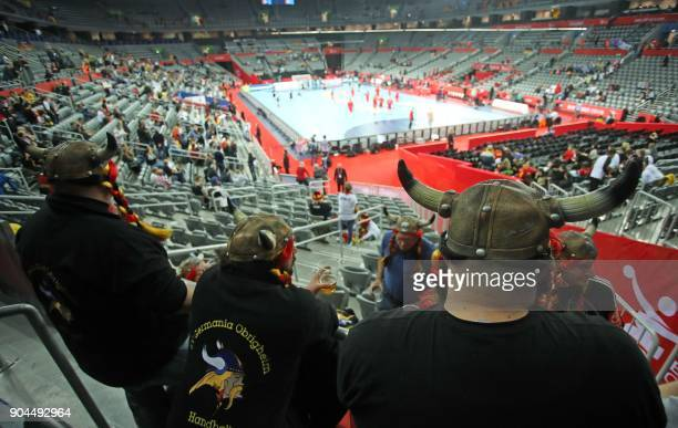 German suporters wearing Viking helmets wait for the start of the preliminary round group C match between Germany and Montenegro during the Men's...