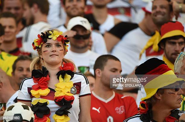 A German supporter cheers for her team ahead of the final football match between Germany and Argentina for the FIFA World Cup at The Maracana Stadium...