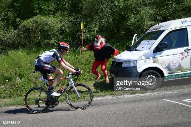 German supporter Didi Senft known as El Diablo cheers as Norway's Vegard Laengen rides in a breakaway during the 216 km sixth stage of the 104th...