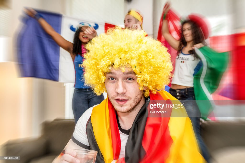 German supporter holding glass of beer : Stock Photo