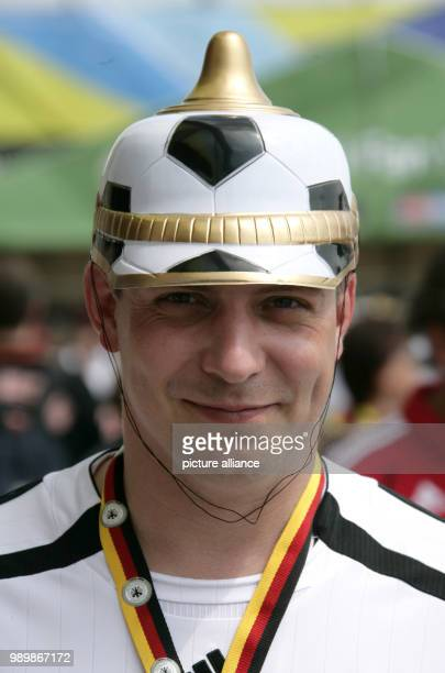 A German supporter wearing a soccer ball shaped helmet prior to the group A preliminary match of 2006 FIFA World Cup Ecuador vs Germany at the...