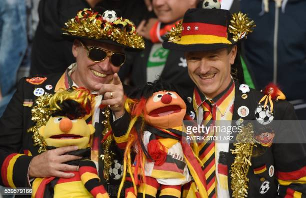 TOPSHOT German supporters are pictured during the Euro 2016 group C football match between Germany and Ukraine at the Stade Pierre Mauroy in...