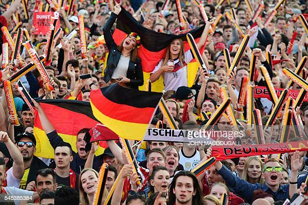 German supporters follow the Euro 2016 semifinal football match Germany v France taking place in Marseille France during the public screening at the...