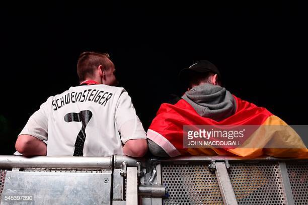 German supporters follow the Euro 2016 semi-final football match Germany v France, taking place in Marseille, France, during the public screening at...