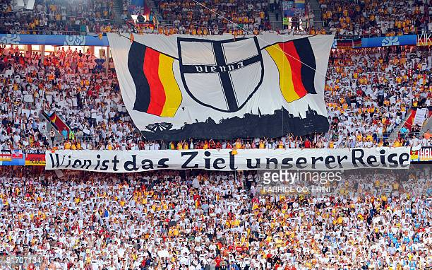 German supporters hold a banner reading 'Vienna is the goal of our journey' prior to the kick off of the Euro 2008 championships semifinal football...