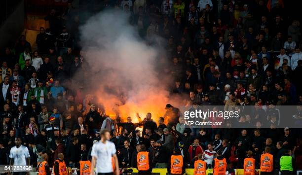 German supporters light flares during the FIFA World Cup 2018 qualification football match between Czech Republic and Germany in Prague Czech...