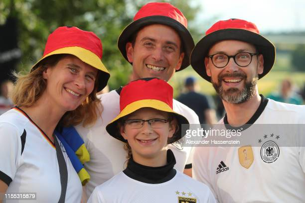German supporters of the Fan Club National Team smile prior to the UEFA Euro 2020 Qualifier match between Germany and Estonia at Opel Arena on June...