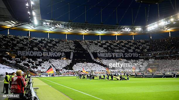 German supporters show their choreography prior to kickoff during the EURO 2016 Qualifier Group D match between Germany and Poland at...