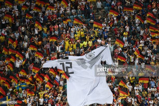 German supporters wave a jersey bearing the number 12 during the Russia 2018 World Cup Group F football match between Germany and Sweden at the Fisht...