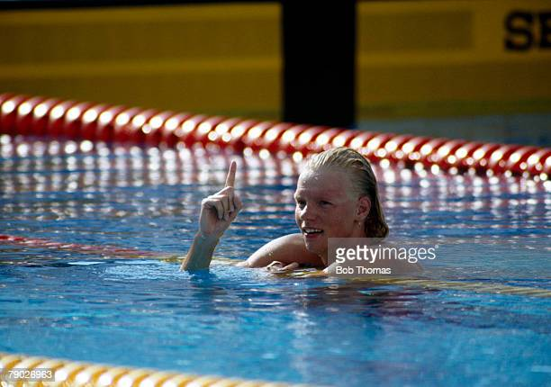 German swimmer Dagmar Hase celebrates after finishing in first place to win the gold medal in the Women's 400 metres freestyle event at the 1992...