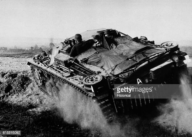 A German tank roars across Poland near Grodno in June 1941 on its way to the Russian border in the initial phase of Hitler's Operation Barbarossa the...