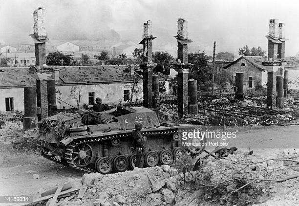 A German tank stopping among the ruins of a city during the KharkovIzium battle Ukraine July 1942