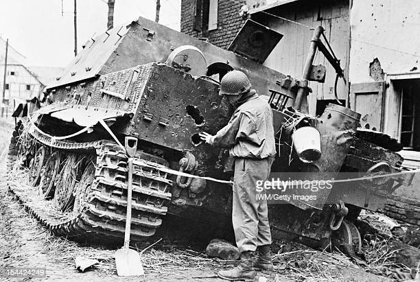 German Tanks And Military Vehicles Of The Second World War A US soldier examines a knockedout Sturmtiger assault gun Germany 1945