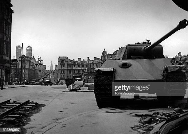 German tanks can be seen on the Stachus Munich Germany with the Frauenkirche in the background left World War II June 1945