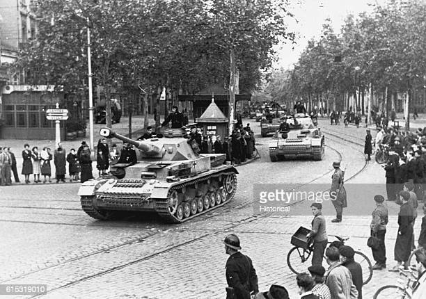 German tanks roll down a street in a town in southern France ca 1940s | Location southern France