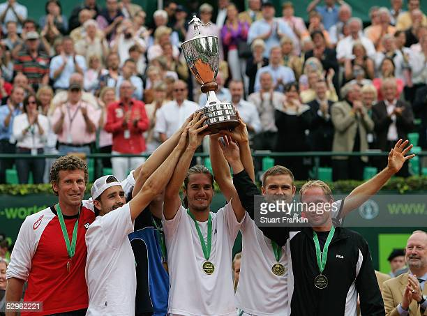 German Team captain Patrick Kuehnen Nicolas Kiefer Florian Mayer Alexander WaskeTommy Haas and Rainer Schuettler of Germany celebrate with the trophy...