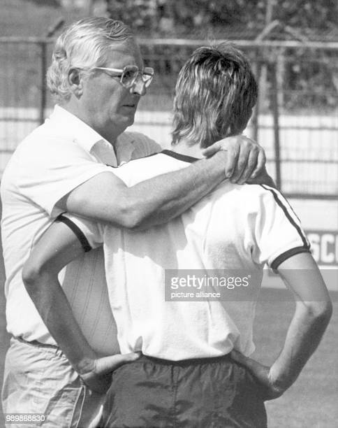 German team coach Jupp Derwall and football player Pierre Littbarski during practice at the World Cup in Spain