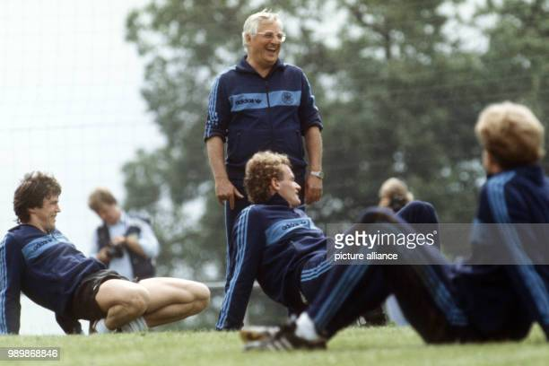 German team coach Jupp Derwall at the practice with team members Klaus Fischer HansPeter Briegel and KarlHeinz Rummenigge during the World Cup in...