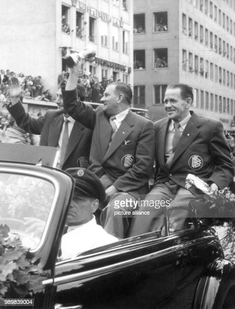 German team coach Sepp Herberger team captain Fritz Walter and DFB vice president Hans Huber in a motorcade during a celebration tour through Munich...