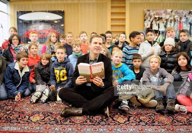 German Team manager Oliver Bierhoff reads the Ritter Raeuber and Spoekenkieker book to the pupils of the Frankfurt Carl von Weinberg school on...