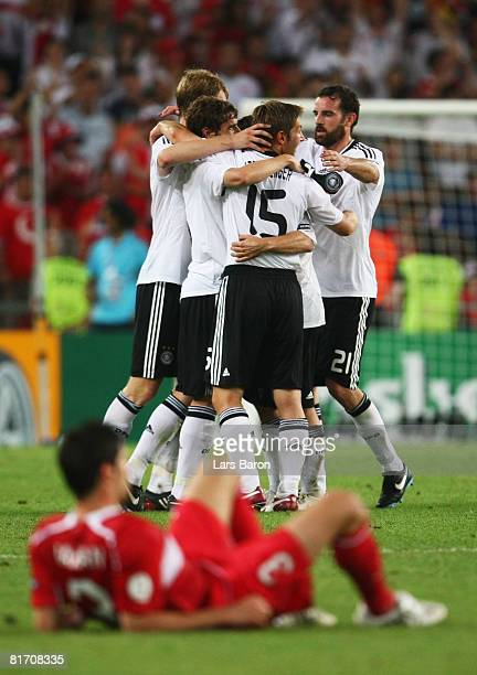 German team members celebrate their victory over Turkey during the UEFA EURO 2008 Semi Final match between Germany and Turkey at St JakobPark on June...