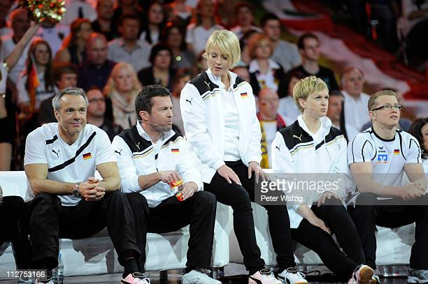 German team members Hannes Jaenicke Lothar Matthaeus Ulla Kock am Brink Karen Heinrichs and Fabian Hammbuechen watch a game during the 'Deutschland...