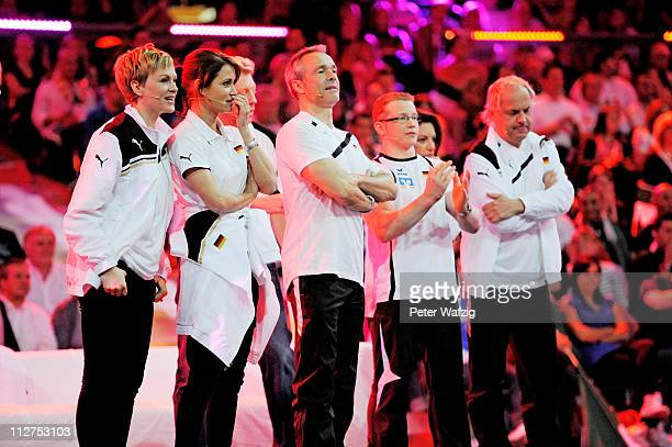 German team members Karen Heinrichs Anja Kling Hannes Jaenicke Fabian Hammbuechen and Uwe Ochsenknecht watch a game during the 'Deutschland Gegen...