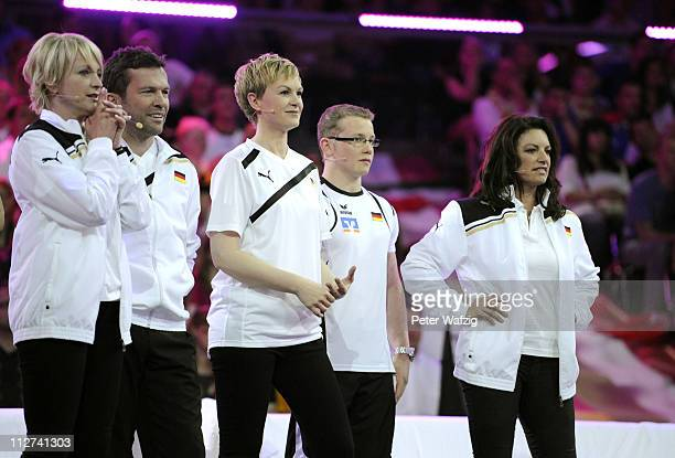 German team members Ulla Kock am Brink Lothar Matthaeus Karen Heinrichs Fabian Hambuechen and Christine Neubauer look on during the 'Deutschland...