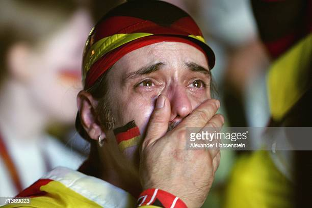 German Team supporter cries after watching the FIFA World Cup 2006 Semi Final match between Germany and Italy at the Fan Fest outdoor viewing area at...