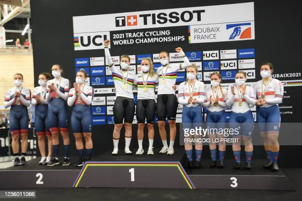 German team's members pose with their gold medals past silver medallist Russian Cycling Federation and bronze medallist Great Britain on the podium...