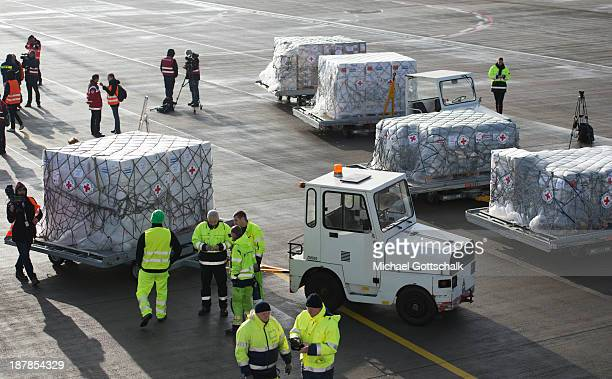 German technical relief organisation THW and the German Red Cross load aid destined for the Philippines at Schoenefeld Airport on November 13 2013 in...