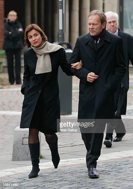 German television journalist Sandra Maischberger and her husband Jan Kerhart arrive for the memorial service for Loki Schmidt wife of former German...