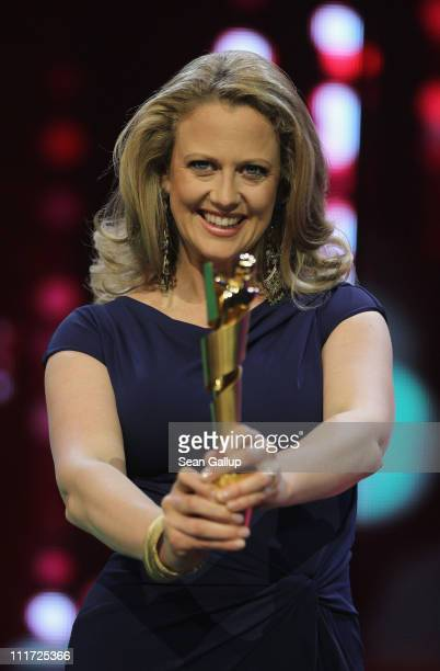 German television presenter Barbara Schoeneberger poses with the Lola German film award at a photocall ahead of the 2011 German Film Award on April...