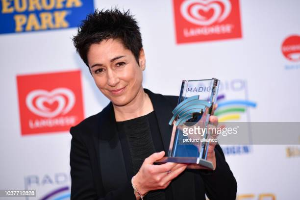 German television presenter Dunja Hayali poses with a Radio Regenbogen Award in the EuropaPark in Rust Germany 07 April 2017 Photo Uwe Anspach/dpa |...
