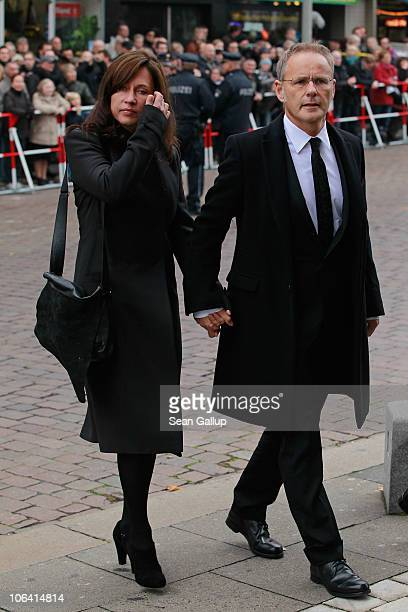 German television presenter Reinhold Beckmann and his wife Kerstin arrive for the memorial service for Loki Schmidt wife of former German Chancellor...