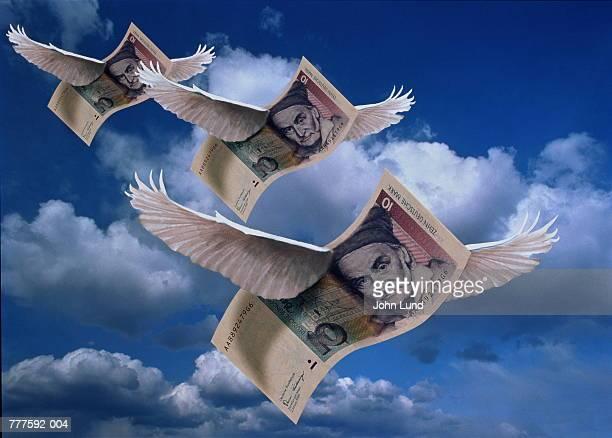 German ten mark notes with wings in sky (Digital Composite)