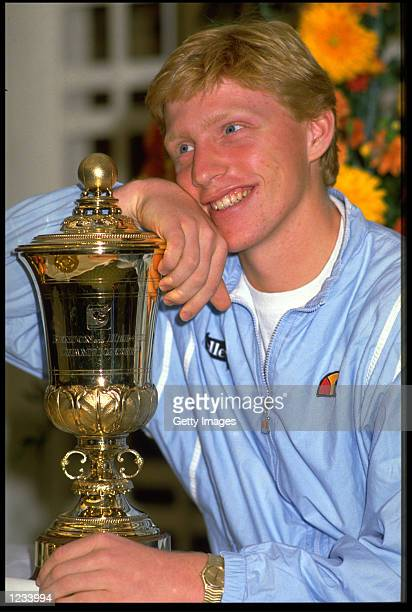 German tennis champion Boris Becker poses with the Benson Hedges Championship trophy mid 1980s