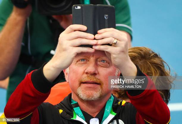 German Tennis Federation Head of the Men's Tennis Boris Becker takes a picture of Alexander Zverev of Germany playing against Nick Kyrgios of...