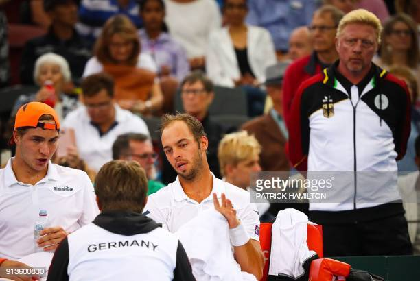 German tennis great Boris Becker looks on as Tim Puetz and JanLennard Struff of Germany receive instructions from Germany's captain Michael Kohlmann...