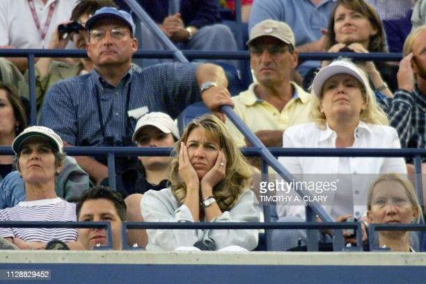 German tennis great Steffi Graf watches number two seeded Andre Agassi of the US and number seven seeded Todd Martin of the US 12 September at the US...