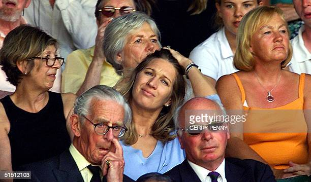German tennis legend Steffi Graf watches her friend US player Andre Agassi playing his first round match against Dutch Peter Wessels at the All...