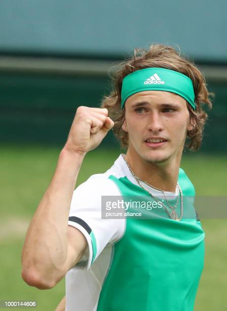 German tennis player Alexander Zverev cheers over his victory at the ATP tennis tournament men's singles quarter final match against Roberto Bautista...