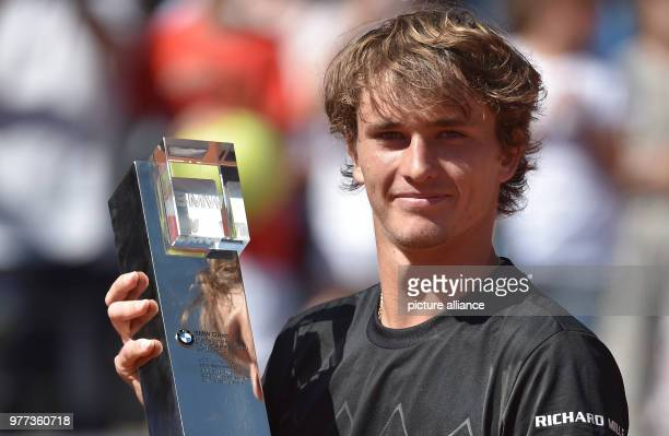 German Tennis Player Alexander Zverev holds up the trophy after winning his 2018 BMW Open men's singles final match against compatriot Philipp...