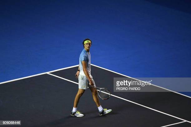 TOPSHOT German tennis player Alexander Zverev pauses on court during his Mexico ATP 500 Open men's single tennis match against US player Ryan...