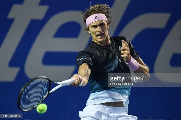 German tennis player Alexander Zverev returns the ball to Australian Alexei Popyrin during their ATP 500 Mexico Open singles match in Acapulco...