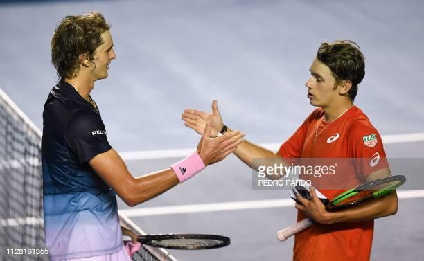 German tennis player Alexander Zverev shakes hands with Australian tennis player Alex de Minaur after winning their Mexico ATP 500 Open men's single...