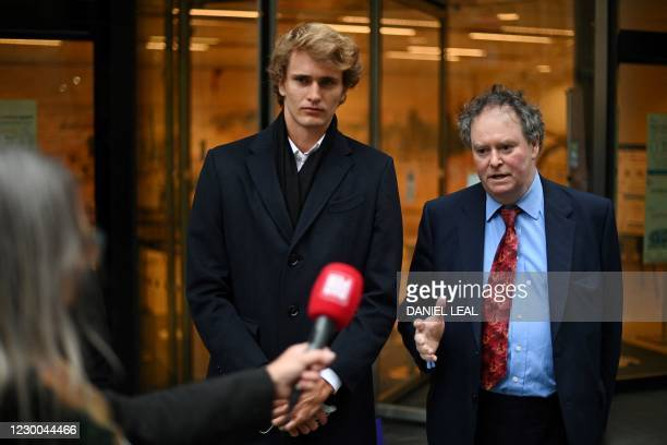 German tennis player Alexander Zverev stands with his lawyer Mark Stephens outside the Royal Courts of Justice, Britain's High Court, in central...